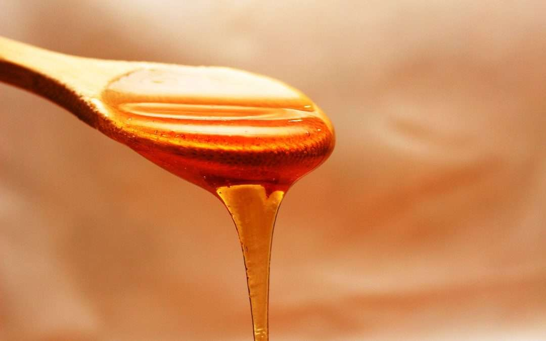 Honey on a wooden spoon